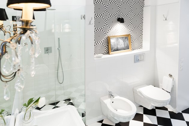 Stylish black and white bathroom interior with checkered patterns