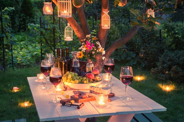 Beautiful table full of cheese and meats in garden