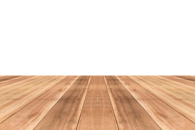 Wooden table top against white background