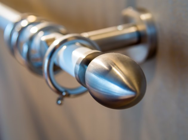 Stainless curtain rod on the wooden wall