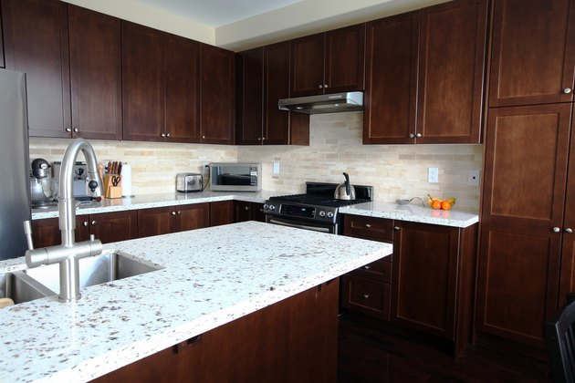 Domestic kitchen with quartz countertops and brown cabinetry