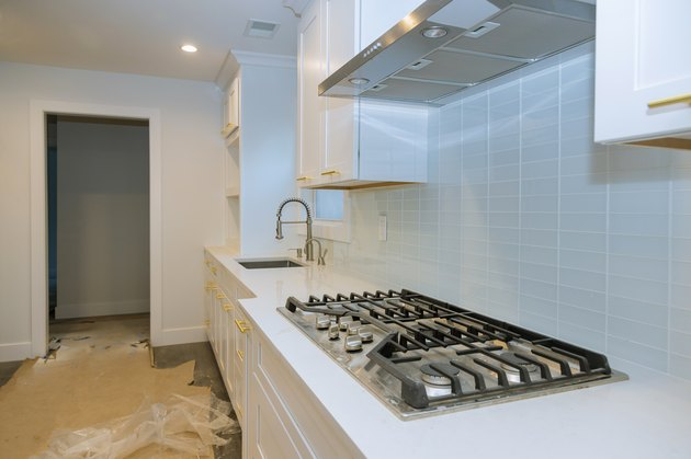 Stainless steel kitchen sink and modern kitchen interior with new oven kitchen in the apartment.