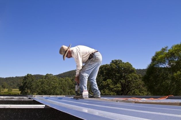 Man building a roof
