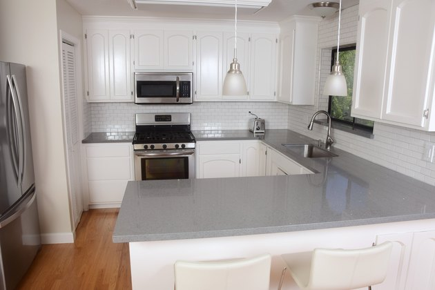 Classic White Domestic Kitchen with Subway Tile and Quartz Counters