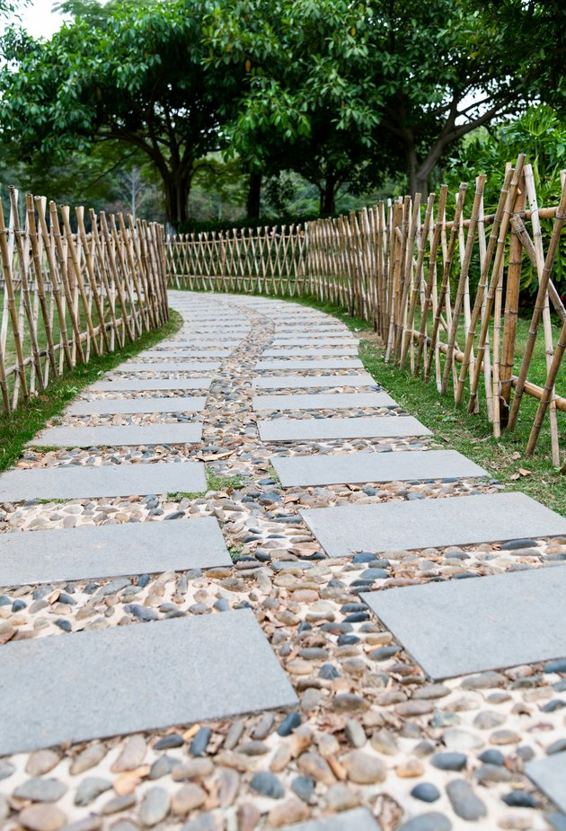 Stone path with bamboo fence in the park