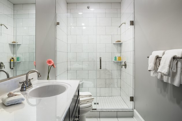 Bathroom interior with walk in shower and gray paint