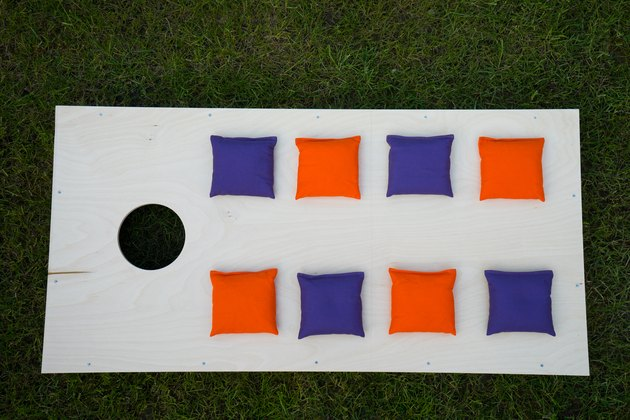 Cornhole Board Flat Lay with beanbags on grass
