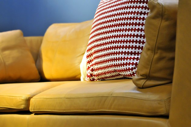 Colorful cushions on couch in home