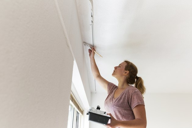 Girl Painting Living Room Ceiling