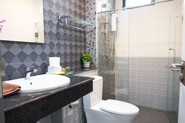 Modern bathroom interior with white toilet and shower