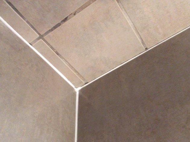 Fresh caulk on shower tile