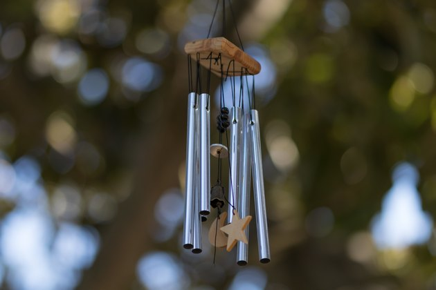 Close-Up Of Wind Chime Hanging Against Trees