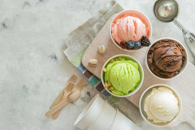 Selection of colorful ice cream scoops in paper cones