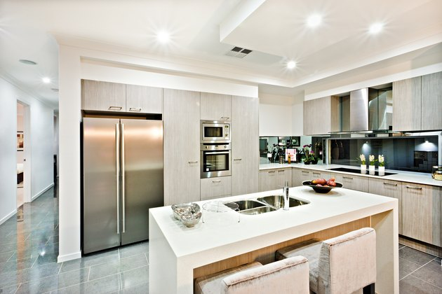 Modern kitchen counter top with a fridge and pantry