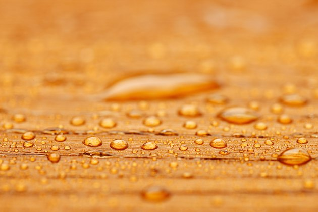 Protected wood after rain - covered with water drops