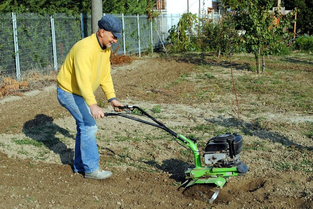 Middle age man with a rototiller