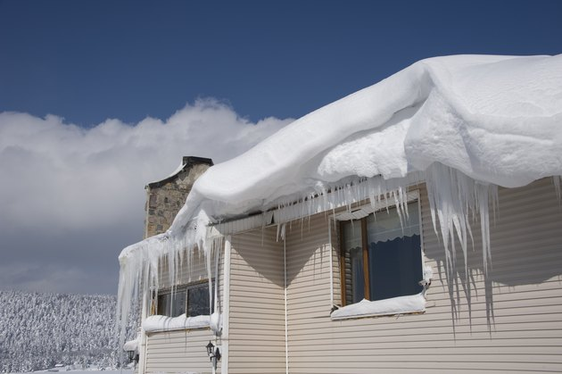 Snow, icicles and ice dam on roof.