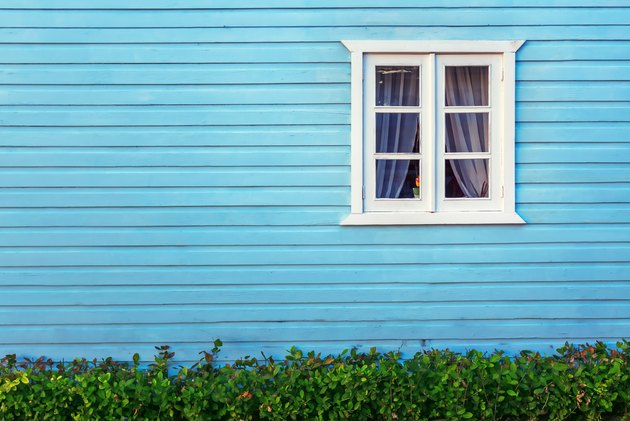 White window on a blue wooden wall in Dominican republic
