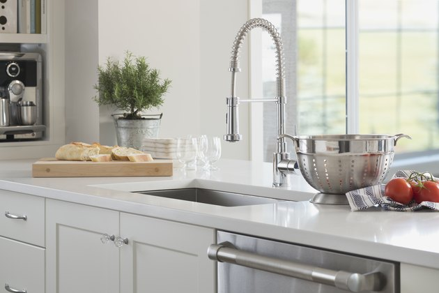 Gooseneck spring faucet in domestic kitchen
