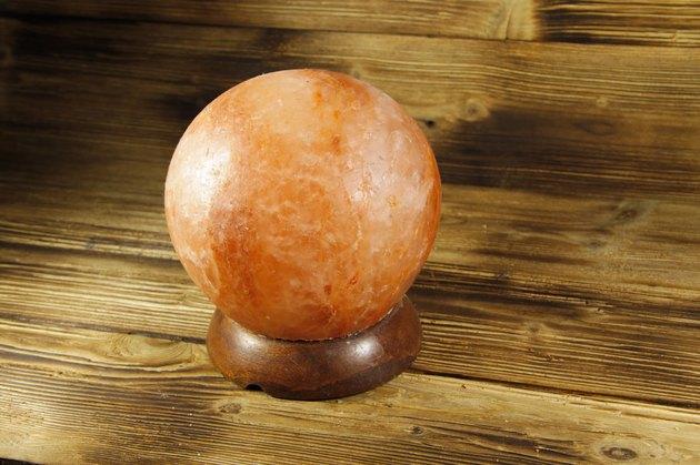 Himalayan salt lamp on wooden background