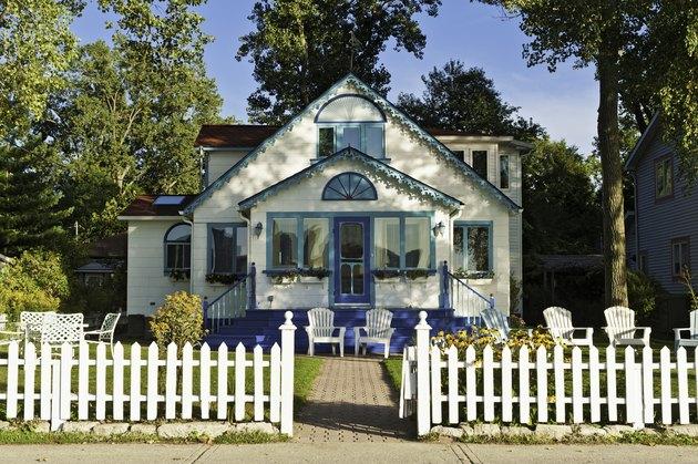 Pretty wooden cottage white picket fence Toronto Island Canada