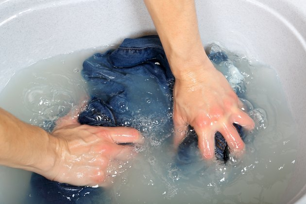 Washing clothes by hand.