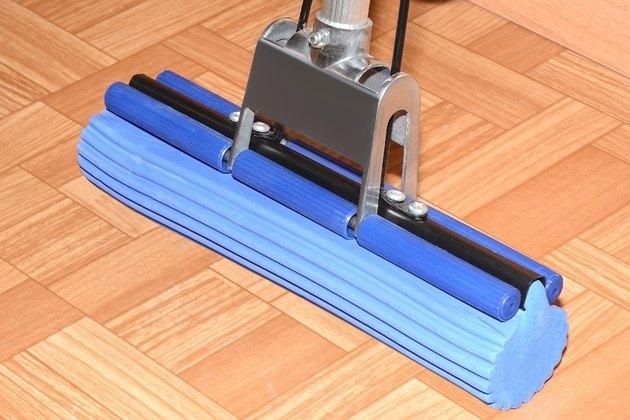 Blue MOP with sponge is on the floor on linoleum