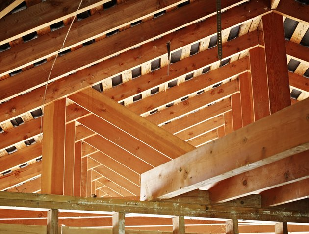 Roof support beams in home under construction