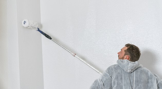 Man painting with a roller.