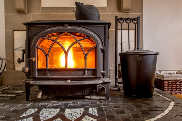 High efficiency cast iron wood stove burning firewood