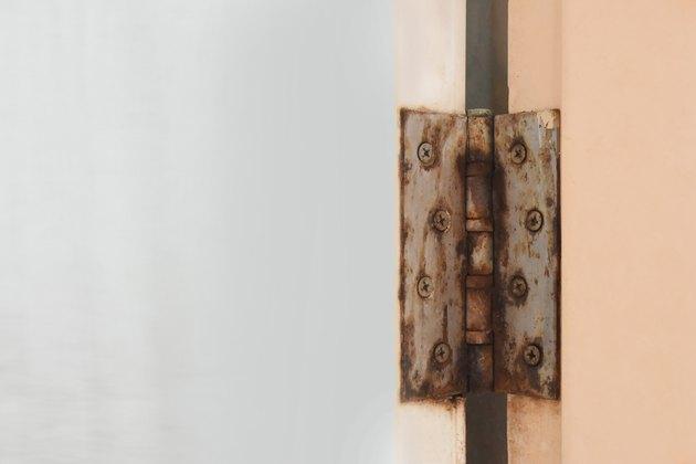 Bathroom door hinge rust.On the door of PVC waterproof and empty space for text.