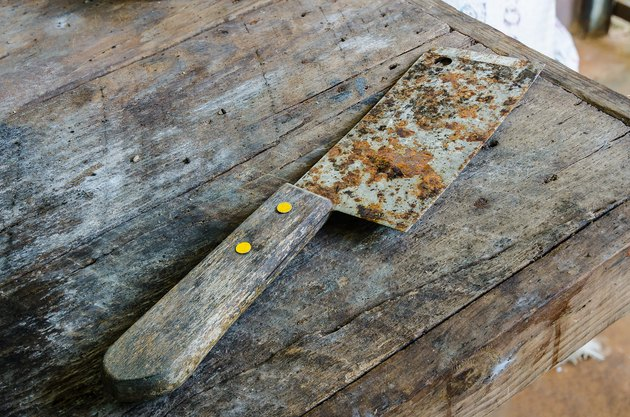 Old Rusty Kitchen Knife on dirty table