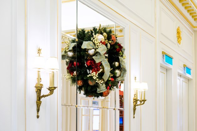 Christmas wreaths on glass window.