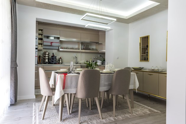 Modern gray kitchen with table set