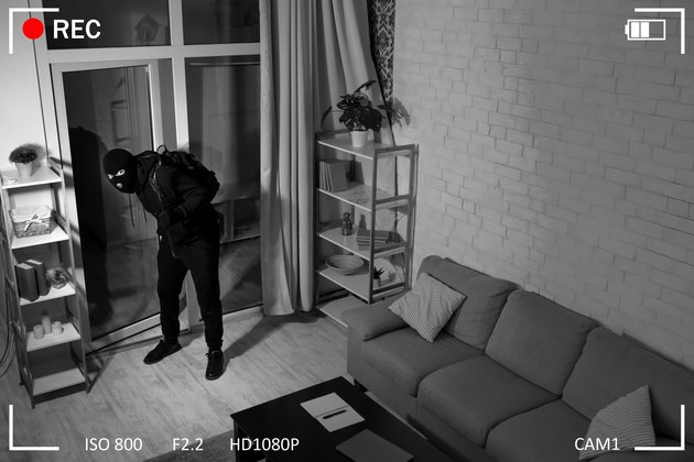 Thief With Crowbar Entering Into House View From Camera