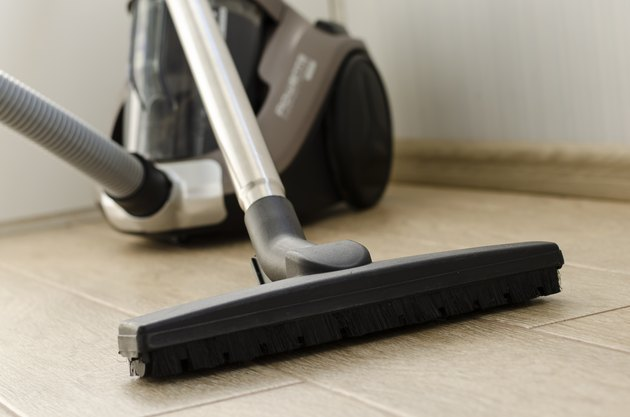 Housekeeping and cleaning concept. Vacuum cleaner nozzle on the floor.
