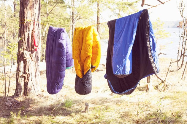 Sleeping bags drying on a clothes line.