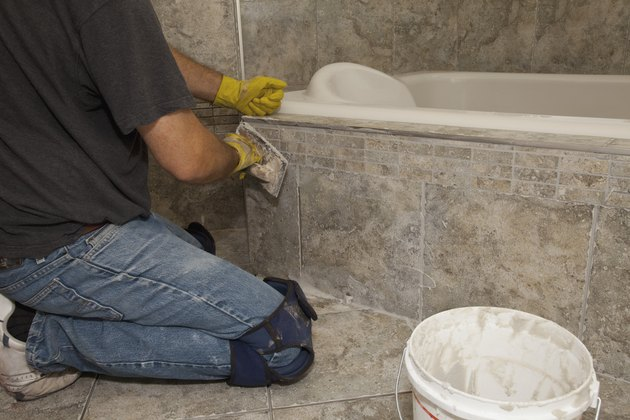 installing tiles for a home renovation