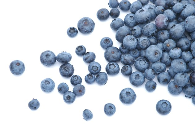 Blueberries scattered on white background