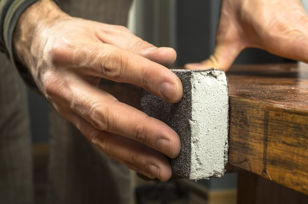 Handyman working with sandpaper