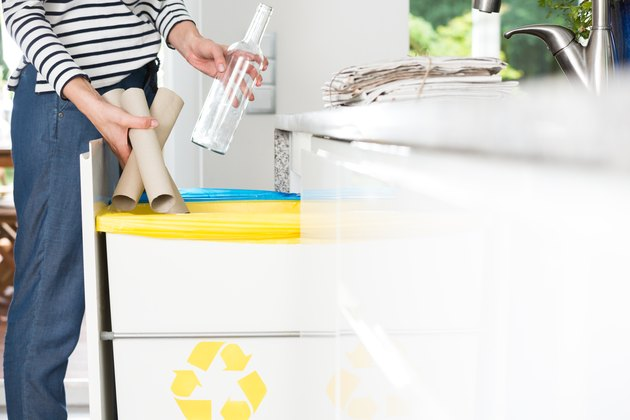 Housewife throwing paper into bin