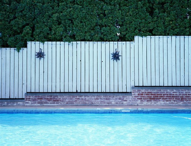 Fence alongside swimming pool