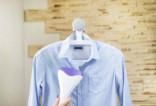 Ironing a shirt with a clothes steamer