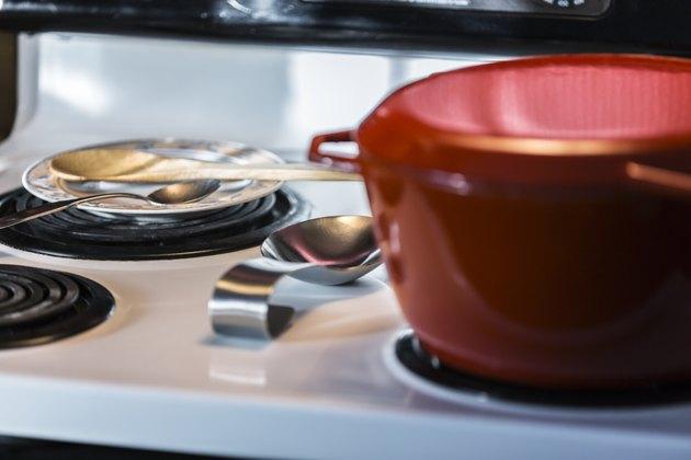 Red Cooking Pot On Kitchen Electric Range Stovetop Circular Burner