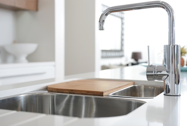 Stainless steel sink with mixer tap