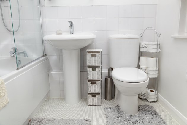 small white modern bathroom with tiles