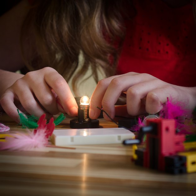 Girl Connects Lightbulb
