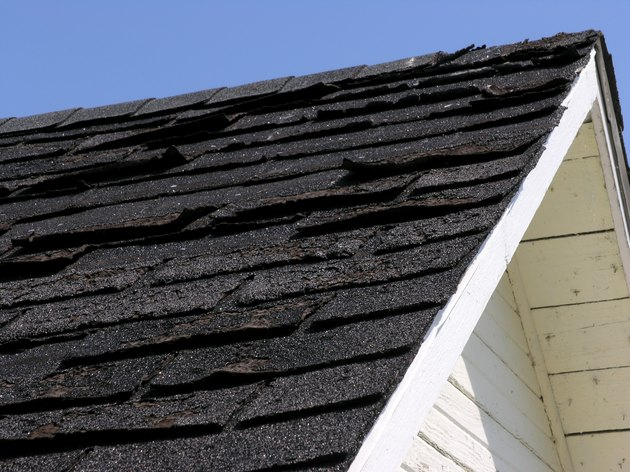Old, damaged roof shingles
