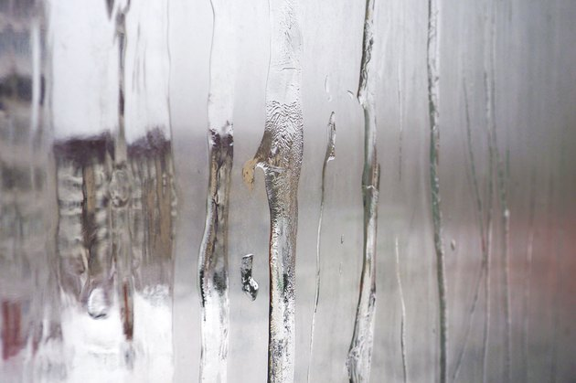 Misted glass Windows with icy potted streams.