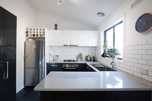 New black and white contemporary kitchen with subway tiles